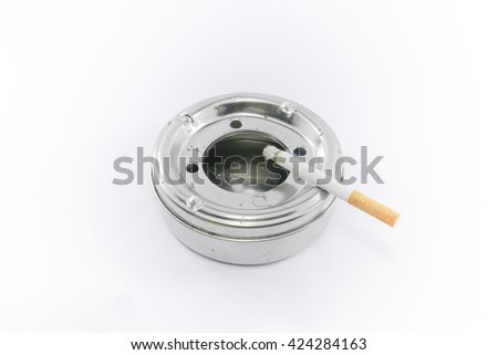 A dirty ashtray with cigarette ash and butts - stock photo