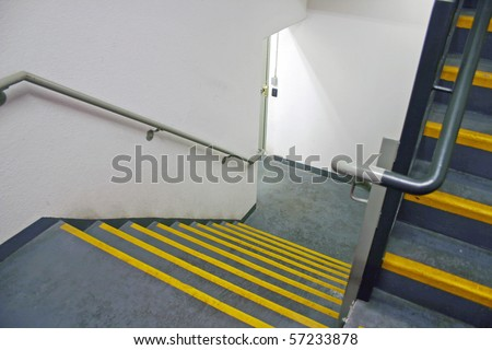 A dirty fire stairway in a modern building. - stock photo