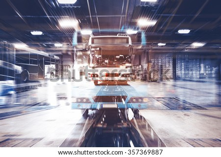 a dirty, oily bus garage inspection pit - stock photo