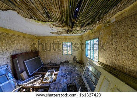 A dirty old ruined room - stock photo