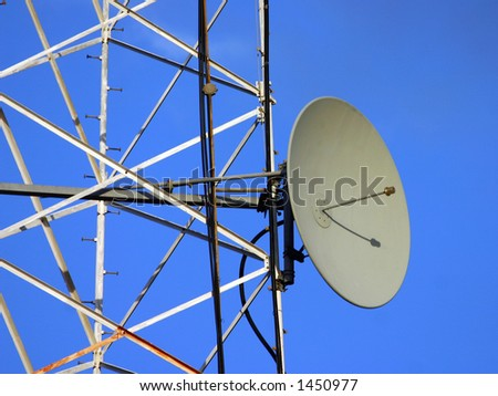 A dish antenna on a metal tower - stock photo