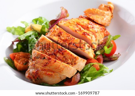 a dish of chicken breast - stock photo