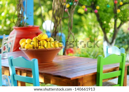 A dish of lemons in typical greek outdoor cafe on Kos island - stock photo