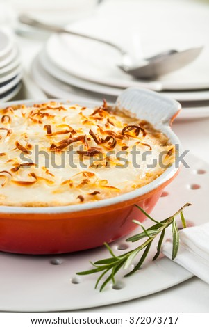 A dish of moussaka, a typical Greek dish, prepared with, eggplant, meat and cheese - stock photo
