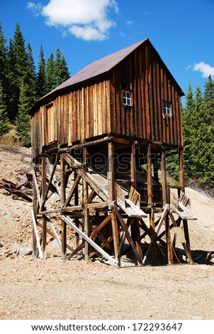 A disused mining shaft in the Red Mountain mining district, between Ouray and Silverton, CO, USA. At the heyday of Ouray, there were more than 30 active mines.  - stock photo