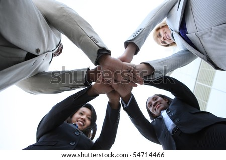 A diverse business man and woman team celebrating success at office building - stock photo