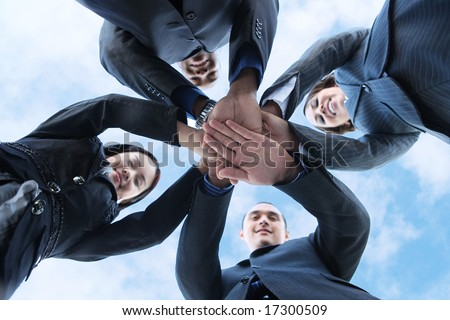 A diverse business man and woman team with hands together a - stock photo
