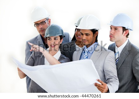 A diverse group of architects studying a plan isolated on a white background - stock photo