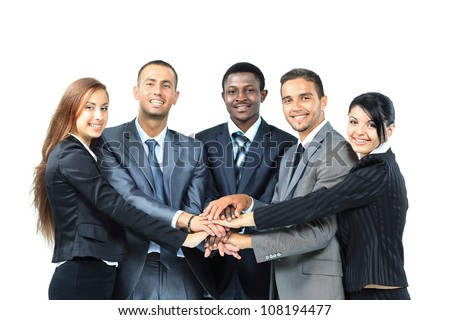 A diverse group of business workers with their hands together in form of teamwork - stock photo