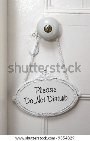 A Do No Disturb sign on a white door - stock photo