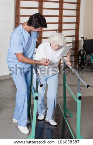 A doctor assisting a senior citizen . - stock photo