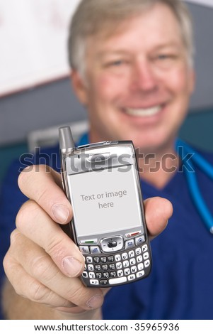 A doctor displays his cell phone as if showing someone the screen display.  The screen comes with a clipping path.  compete with the white chassis. - stock photo