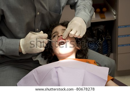 A doctor examines the problematic tooth - stock photo