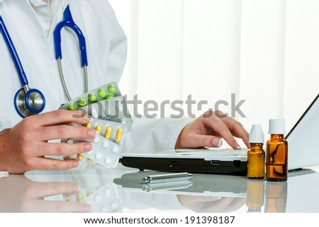 a doctor issues a prescription for medication. prescription tablets from the pharmacy. - stock photo