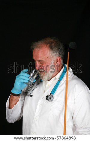 "a doctor or surgeon enjoys an ""adult beverage"" right before or after surgery - stock photo"
