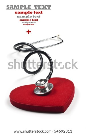 a Doctor's stethoscope listening to a healthy red heart - stock photo