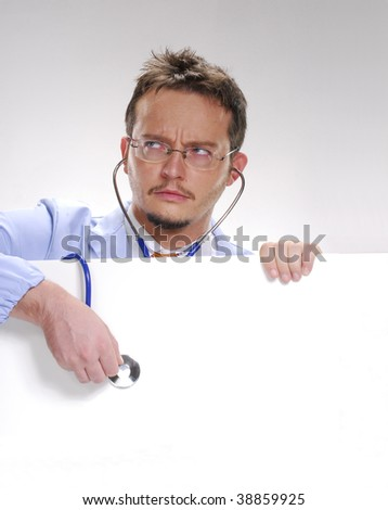 A doctor usin a Stethoscope over a white card. - stock photo