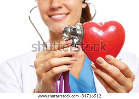 A doctor with stethoscope examining red heart,  isolated on white - stock photo