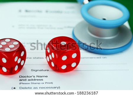A Doctors light blue colored stethoscope with two red dice laid next of it, both resting on a doctors sick certificate pad, asking the question do you gamble with your health. - stock photo