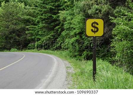 A Dollar Sign on a Side of a Country Road with a Copyspace - stock photo