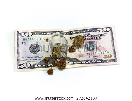 A 50 dollar US currency bill with marijuana pot buds on top, over white. - stock photo
