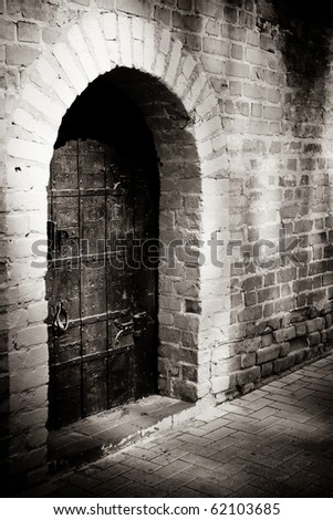 A door in a brick-wall of a Medieval tower - stock photo