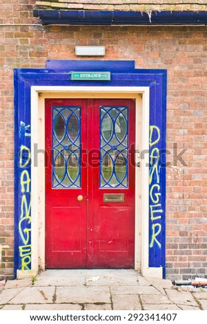 A door in a building with danger signs - stock photo
