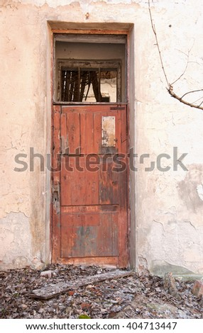 A door in Destroyed building. Concept demolition, war, earthquake, catastrophe, disaster - stock photo