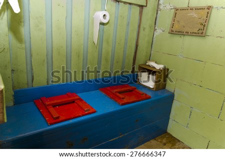 A double seated old outdoor toilet from the North of Sweden. - stock photo