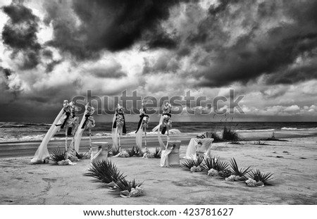 A Dramatic Image of a Wedding Set Up on a Stormy Beach. Filter applied for effect.  - stock photo