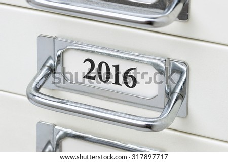 A drawer cabinet with the label 2016 - stock photo