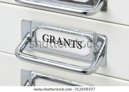 A drawer cabinet with the label Grants - stock photo
