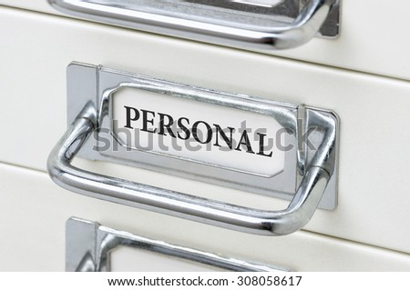 A drawer cabinet with the label Personal - stock photo