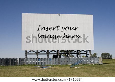 A drive-in movie screen with words. - stock photo