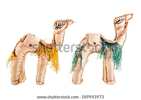 a dromedary puppet isolated over a white background - stock photo