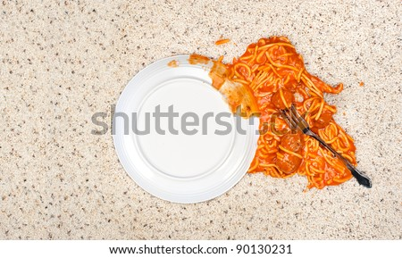A dropped plate of spaghetti on new carpeting. - stock photo