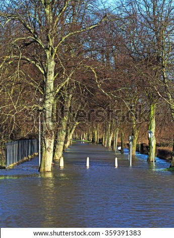 A drowned footpath during floods - stock photo