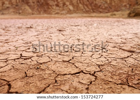 A dry cracking red earth terrain.  - stock photo