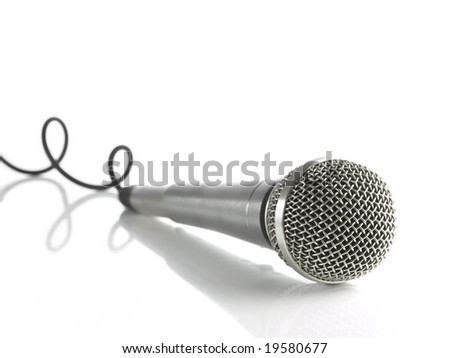 A dynamic mic with a curled cable over white. - stock photo