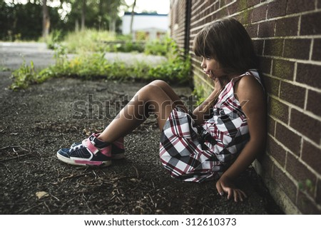 A eight years old school girl close to the schoolyards - stock photo