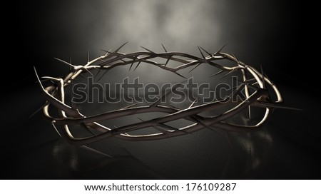 A eye level view of branches of thorns woven into a crown depicting the crucifixion on a dark reflective surface spotlit by an eerie light - stock photo