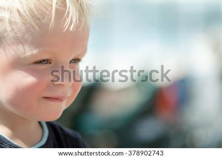 A face of a cute little boy on a beach. Shallow dof - stock photo