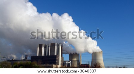 A factory producing a lot of smoke and pollution which is bad for the environment - stock photo