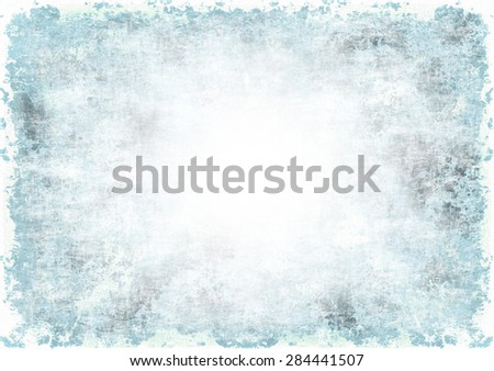 A faded grunge background in blue on white with copy space - stock photo