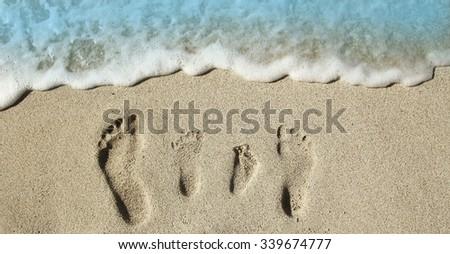 a Family feet on the sand on the beach - stock photo