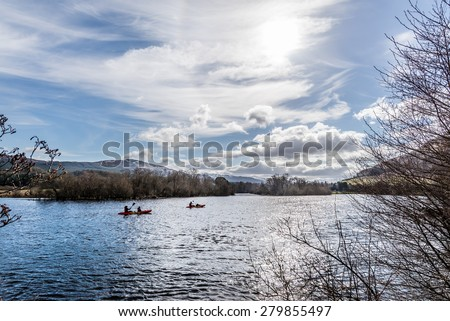 A family kayaking on Loch Tay, Scotland in springtime, - stock photo