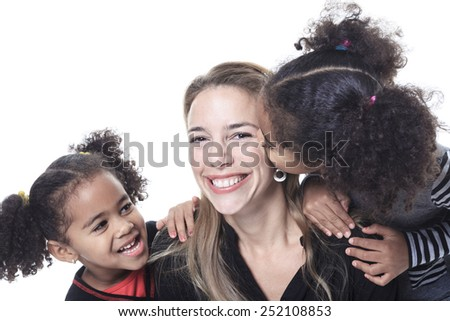 A family posing on a white background studio - stock photo