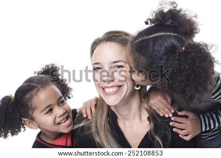 A family posing on a white background studio - stock photo