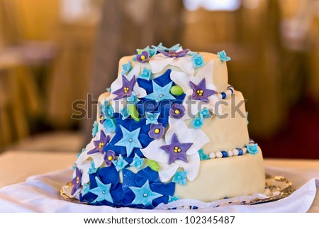 A Fancy fall themed wedding cake with sugar leaves stars down th - stock photo