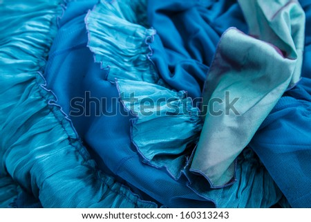 A fancy wrinkled blue fabric background  - stock photo